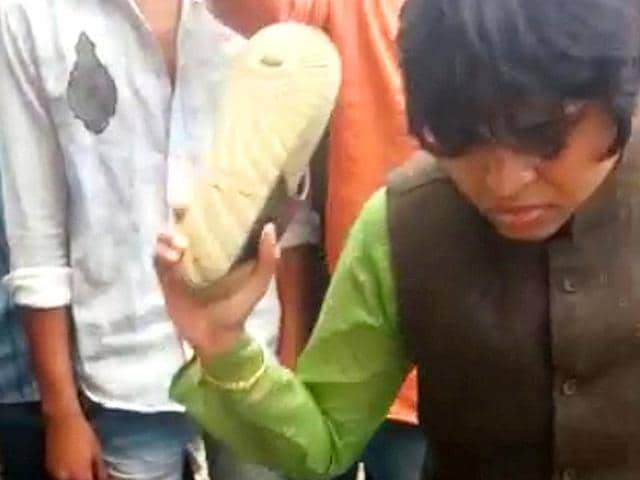 Woman rights activist Trupti Desai recently beat up a man for refusing to marry  a woman with whom he was allegedly having an affair.  (Combo pictures from video grab)