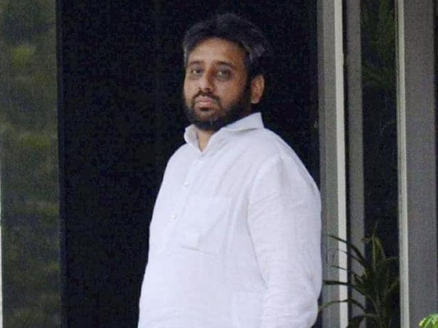AAP MLA Amanatullah Khan at the police station after his arrest on charges of threatening a woman with rape, murder in New Delhi.