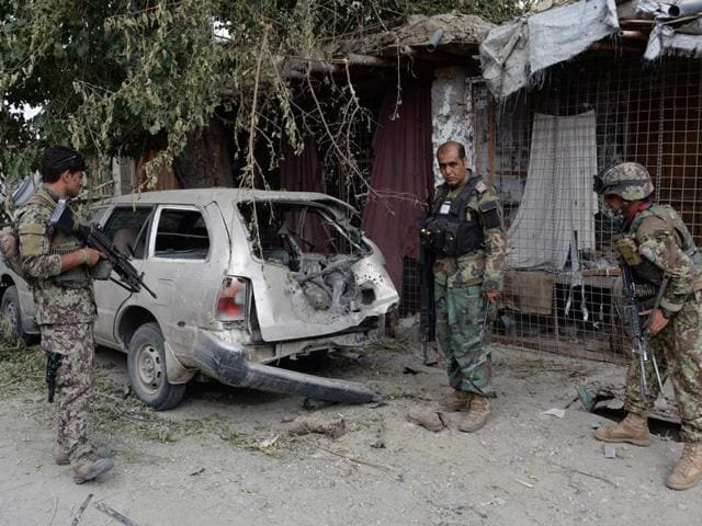 An Afghan soldier inspects a destroyed vehicle after an operation to capture Islamic State fighters in Kot district of eastern Nangarhar province on Tuesday.