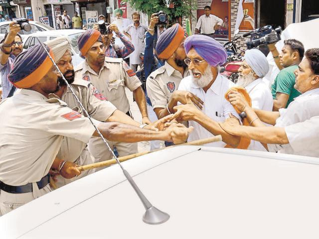A farmer being stopped by police during a protest march opposite mini-secretariat in Bathinda on Tuesday.