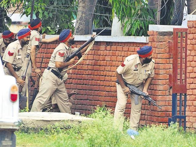 Policemen taking positions outside the Dinanagar police station in Gurdaspur district during a terror attack on July 27, 2015.