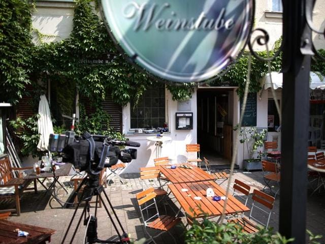 A TV camera stands near the site of a bomb attack, in the courtyard of 'Eugen's Weinstube' vine tavern in Ansbach, Germany.