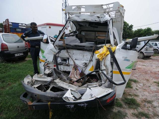 A 35-year old man and his three year old son died while three other family members were injured when an auto they were travelling in rammed against a stationary truck at Yamuna Expressway in Greater Noida on Tuesday.