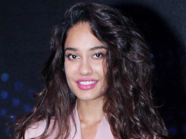 Lisa Haydon says Karan Johar is an amazing director, and deserves all the hype that surrounds him.