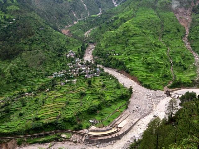 A general view of debris of rocks and fallen trees after monsoon floodwaters receded from the village of Jakhane, near Karanprayag, Chaomli district in Uttarakhand.