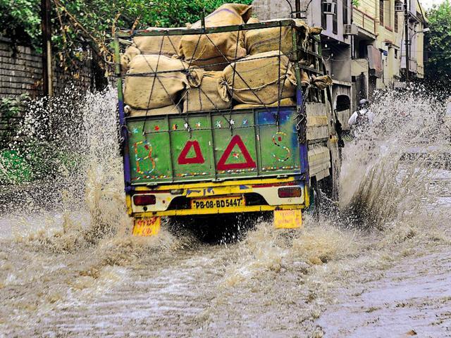A truck passing through the Lakkar Bridge area.