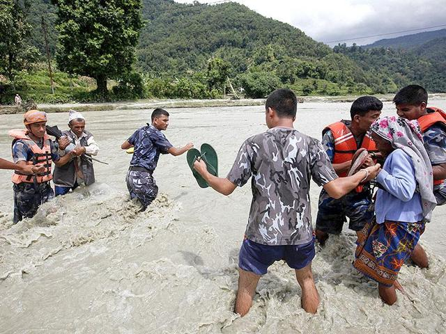 Hundreds of people have been displaced after swollen rivers breached their banks and flooded homes.