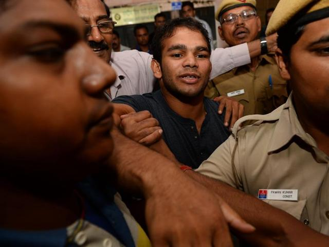 Narsingh Yadav (centre) arrives at the National Anti-Doping Agency office in New Delhi on Wednesday for hearing on his positive dope test.