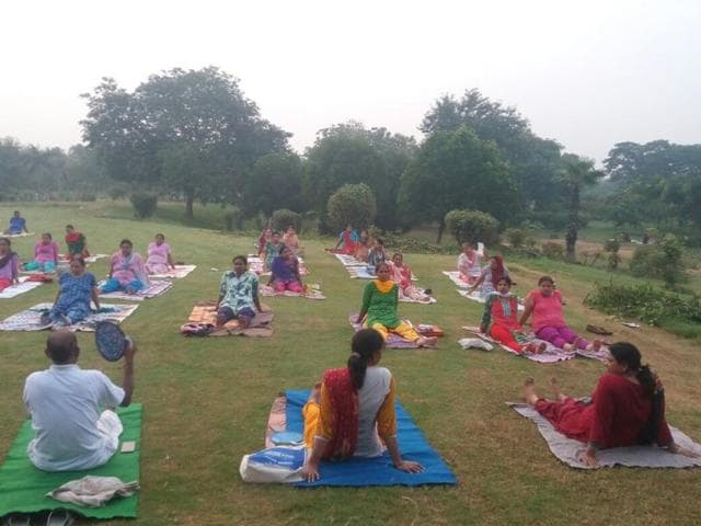 The group includes working professionals and senior citizens and they practice yoga everyday at Ram Manohar Lohia Park.
