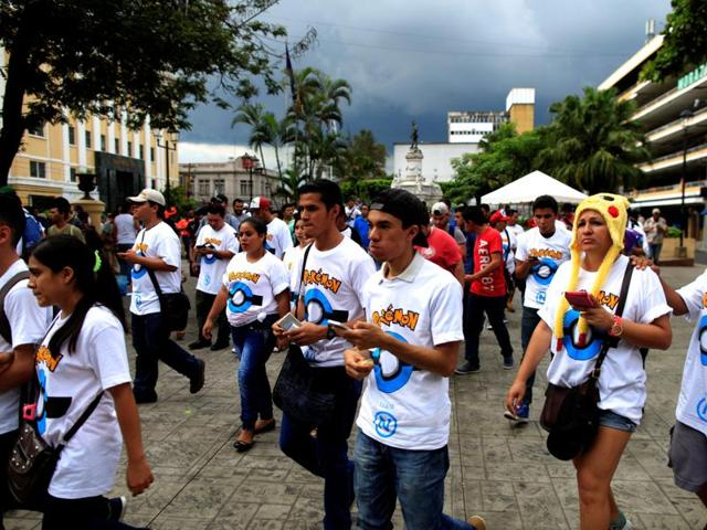 People play Pokemon Go during a poketour organised  in San Salvador, El Salvador on July 23, 2016.