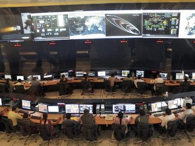 Indian Space Research Organization (ISRO) scientists and engineers at their Spacecraft Control Centre in Bengaluru.