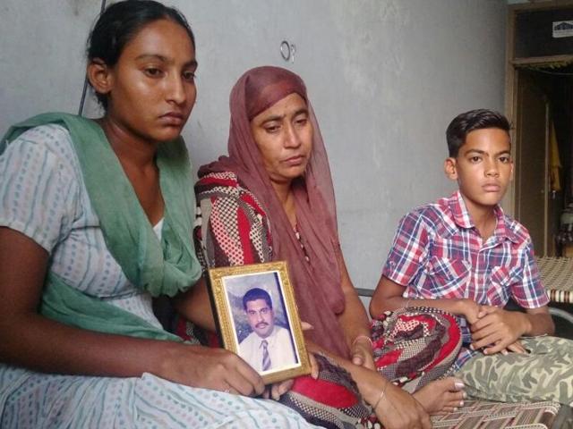 From left: Gurdip Singh's daughter Manjot Kaur, wife Kulwinder Kaur and son Sukhbir Singh at their house in Khehra Mohalla of Nakodar in Jalandhar district.