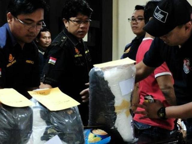Indonesian police display 60 kilograms of methamphetamine, smuggled from Cameroon and Malaysia, before a press conference in Jakarta on July 27.