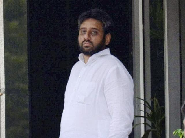AAP MLA from Okhla Amanatullah Khan is seen at a police station following his arrest on charges of threatening a woman with rape, murder in New Delhi.