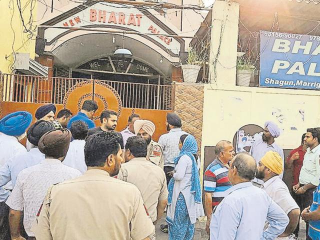 Municipal corporation officials sealing a marriage palace in Amritsar on Wednesday.