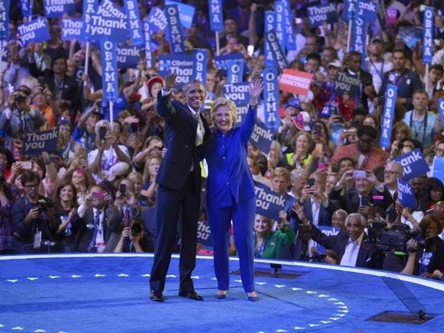 President Barack Obama and Democratic presidential nominee Hillary Clinton waves to delegates at the conclusion of President Obama's speech during the third day of the Democratic National Convention in Philadelphia.