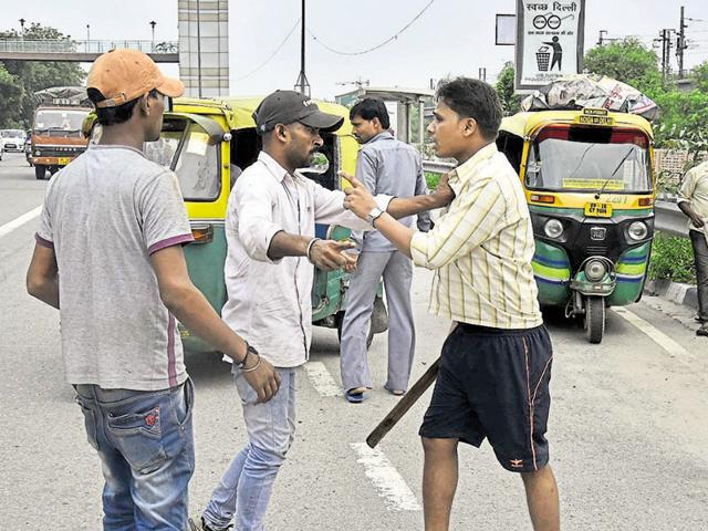 Auto drivers stopping other autos from plying during the auto-taxi driver strike in Delhi  on Thursday.