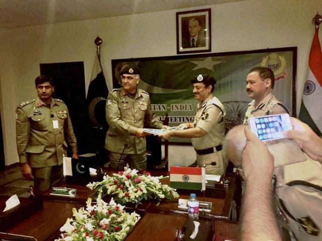BSF director general KK Sharma greets Umar Farooq Burki, the director general, Pakistan Rangers (Punjab),  at a bi-annual meeting in Lahore on Thursday.