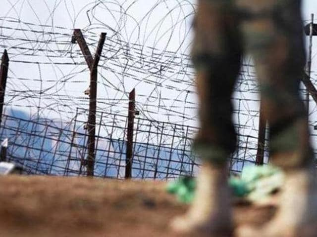 A soldier patrols near the line of control in Mendhar, Poonch district.