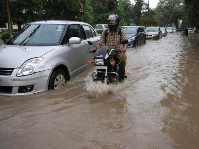 Thursday's  evening showers caused vehicles to be held up on the Delhi-Gurgaon Expressway on Thursday.