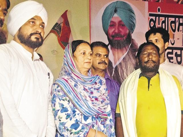 CLP leader Charanjit Singh Channi (extreme left) honouring families of Dina Nagar attack in Dina Nagar in Gurdaspur district on Wednesday.