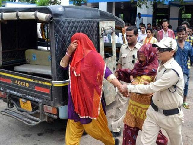 Two Muslim women accused of carrying beef, at Mandsaur railway station on Tuesday.