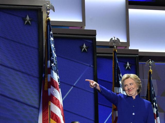 US Presidential nominee, Hillary Clinton, gestures to US President Barack Obama speaks during the third night of the Democratic National Convention at the Wells Fargo Center in Philadelphia, Pennsylvania, July 27, 2016.