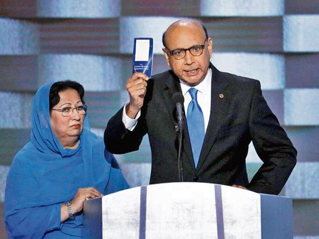 Khizr Khan, whose son Humayun (left) was killed serving with the US Army in Iraq, challenges Republican presidential nominee Donald Trump to read his copy of the US Constitution, at the Democratic National Convention in Philadelphia.