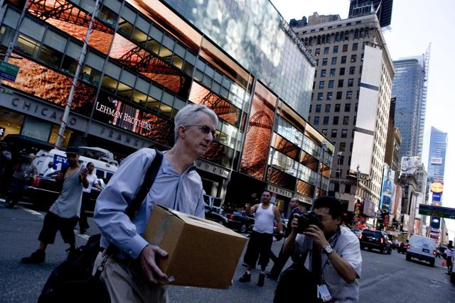 An employee leaving the headquarters of Lehman Brothers, shortly after the American investment bank went bankrupt on September 15, 2008.