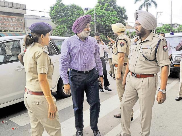 Police commissioner Jatinder Singh Aulakh with other officers outside Deep Hospital in Ludhiana on Thursday.