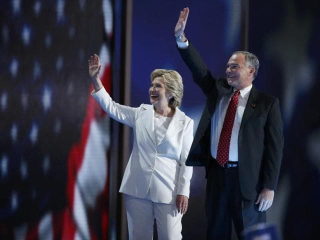 Democratic presidential nominee Hillary Clinton waves with her vice presidential running mate Senator Tim Kaine after accepting the nomination on the fourth and final night at the Democratic National Convention in Philadelphia, Pennsylvania.