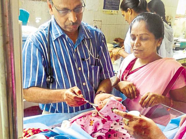 Doctors at a government-run hospital feed a newborn girl who was abandoned by her mother in some bushes in Udaipur's Darod village earlier this month.