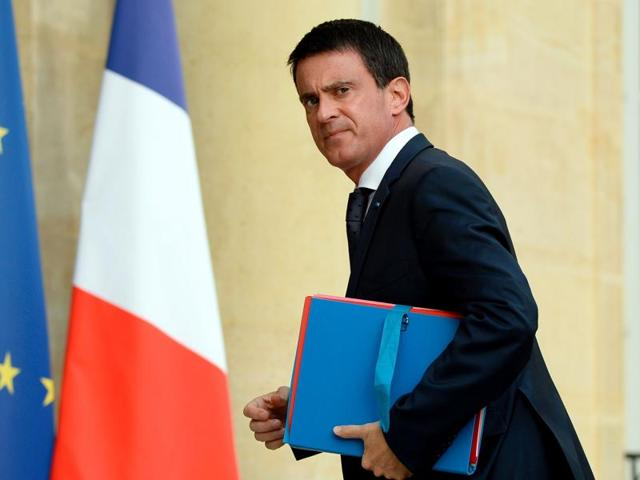 French Prime Minister Manuel Valls arrives at the Elysee Palace in Paris on Wednesday for a meeting with French President and French representatives of the different religion following yesterday attack at a church in Saint-Etienne-Du-Rouveray.