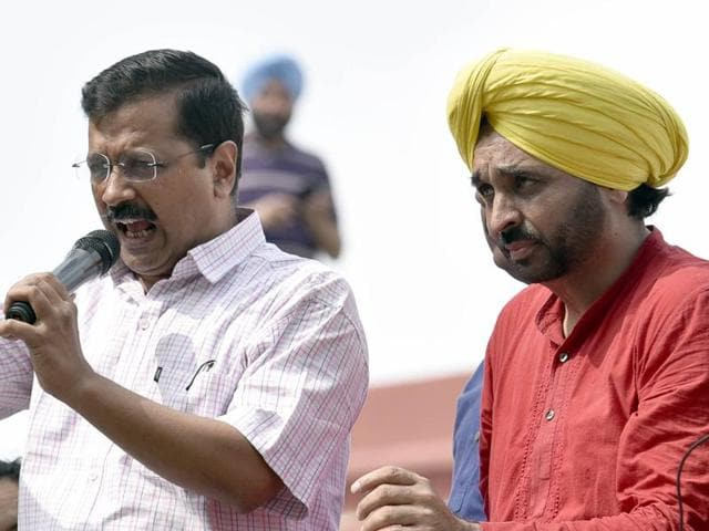 Delhi CM Arvind Kejriwal interacting with his supporters at Circuit House in Amritsar before appearing in the district court on Friday