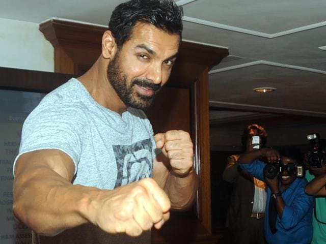 John Abraham poses for the shutterbugs in Mumbai on July 28.