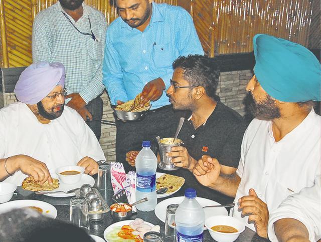 Capt Amarinder Singh having lunch after the Halke-Vich-Captain programme near Shahkot on Thursday.