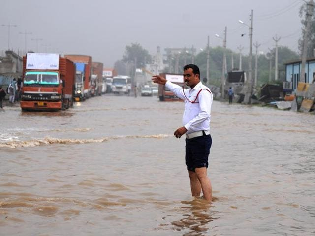 Heavy traffic jam seen at Signature Tower Chowk, NH8 due to heavy rainfall in Gurgaon, India, on Friday, 29 July.