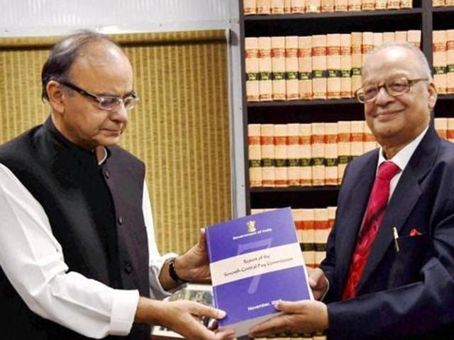 Finance minister Arun Jaitley receiving the report of the  Seventh Pay Commission from its chairman Justice AK Mathur in New Delhi.