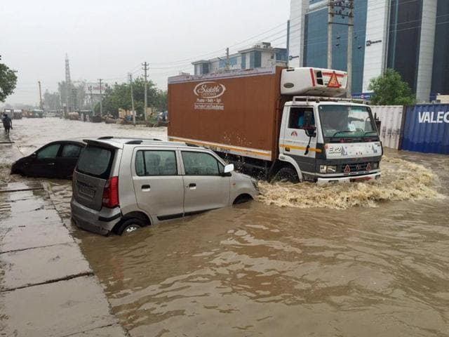 A view of a flooded road near Hero Honda Chowk in Gurgaon.