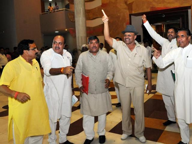 BJP MLAs shouting slogans against the Congress party MLAs after the monsoon session, in Bhopal on Friday.