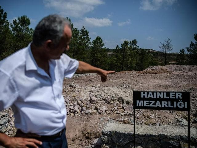 A man points a sign reading in Turkish language
