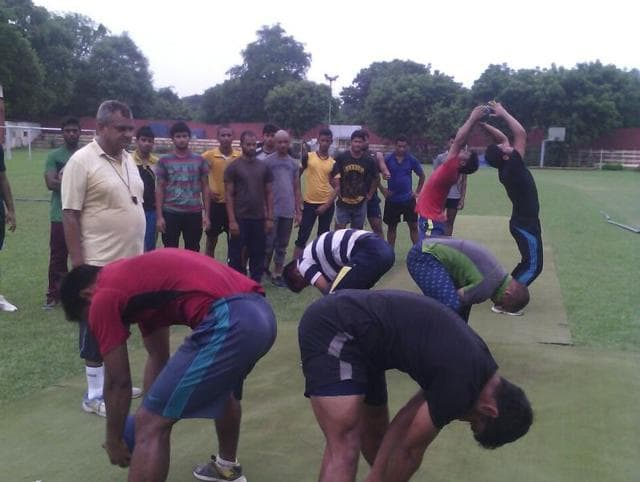 Rustam Khan (left) watching athletes being trained in Allahabad.