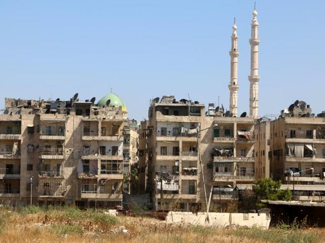 Buildings are seen near the road, which was believed to be used by civilians to access one of the safe exit points opened for civilians intending to leave rebel-held areas, in Aleppo's Bustan al Qasr, Syria.