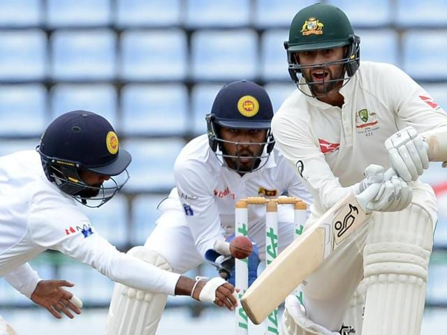 Sri Lanka's captain Angelo Mathews (C) and teammates leave the grounds with the stumps after victory.