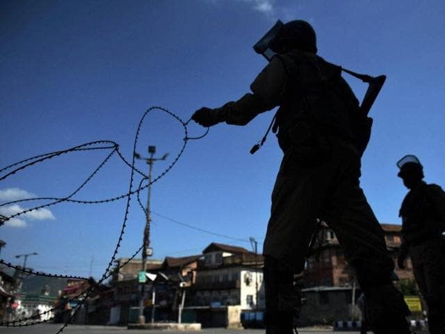 Soldiers block a road with wires during a curfew in Srinagar on Friday.