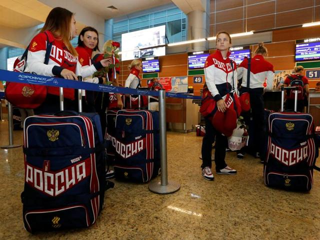 Russia's women's handball Olympic team members go through check-in before national team's departure.