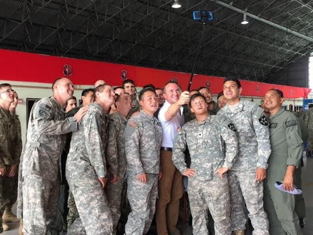 US army secretary Eric Fanning, fourth from right, takes a selfie with fellow personnel during an annual joint military exercise with the Malaysian army in Johor Bahru, Malaysia.