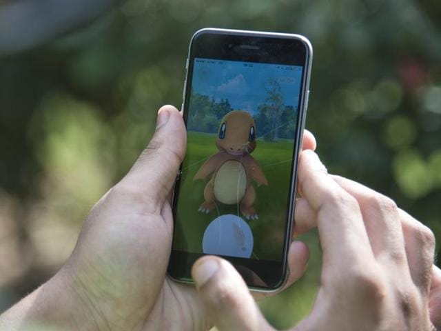 A Pokemon Go player attempts to catch Charmander, one of Pokemon's most iconic creatures, in New Delhi.
