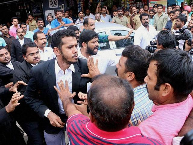 Lawyers clash with media persons during a protest march in front of the Kerala high court in Kochi.