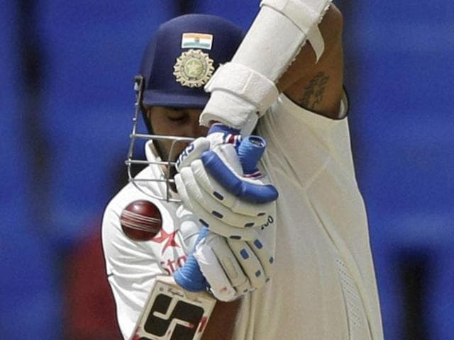 India's Murali Vijay plays a shot bowled by West Indies' Shannon Gabriel to be caught and dismissed.